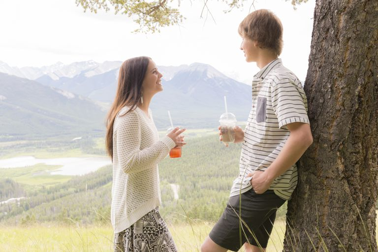 Young couple having discussion at mountain overlook