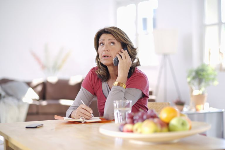 concerned woman on telephone
