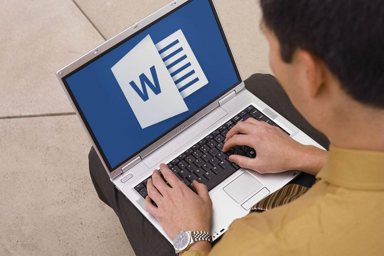 Man using laptop with Microsoft word logo composite