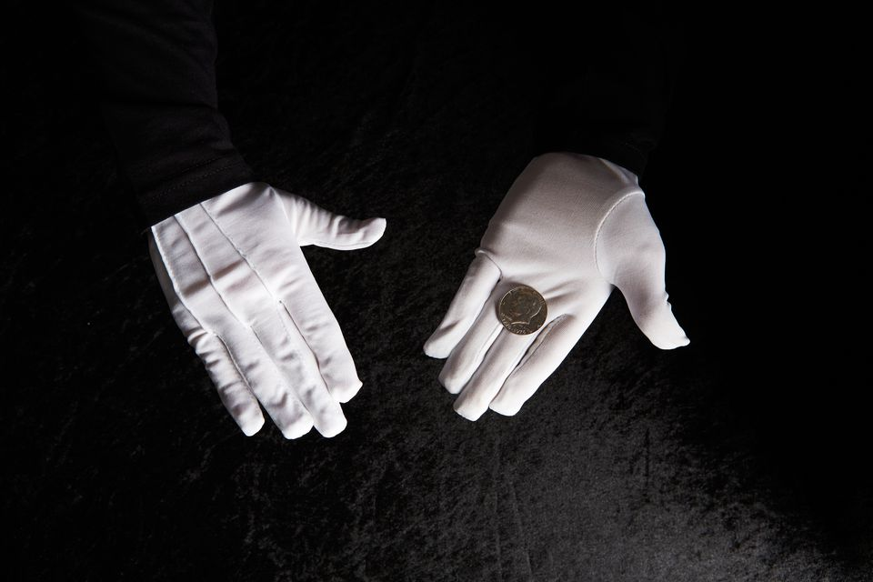 Magician holding coin