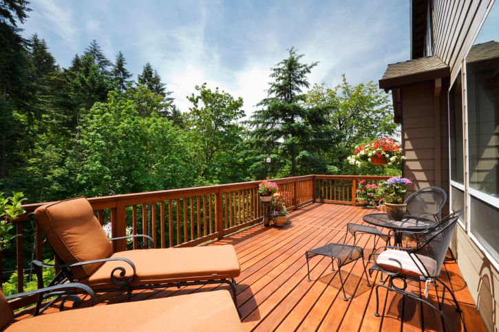 sunny wooden deck with furniture