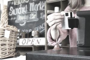 Woman Scanning Credit Card