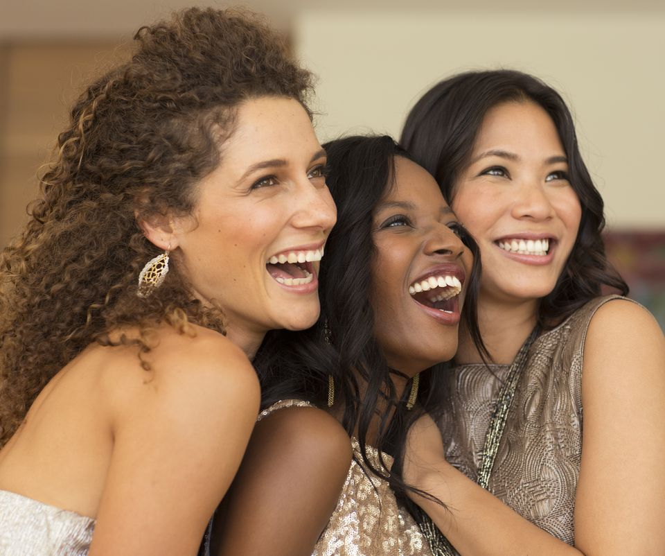 Women smiling together at party