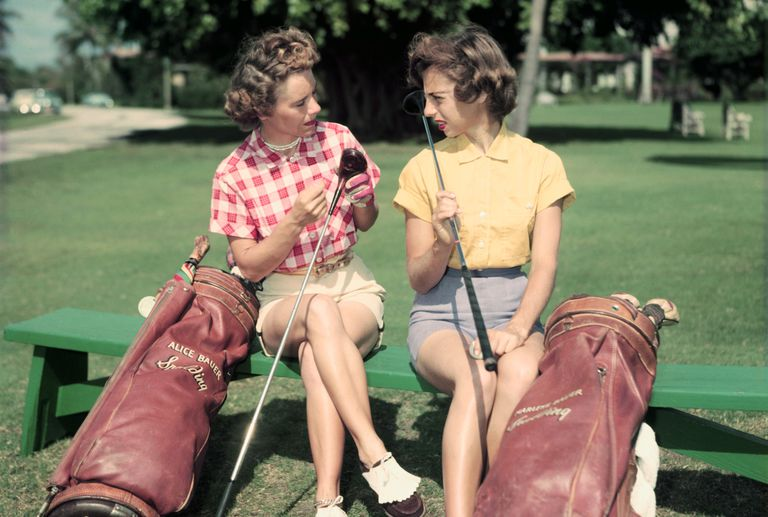 Professional golfing sisters Alice and Marlene Bauer sit talking together on the golf course