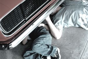 Working on a Broken Down Car