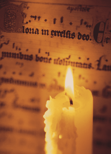 Medieval sheet music candle