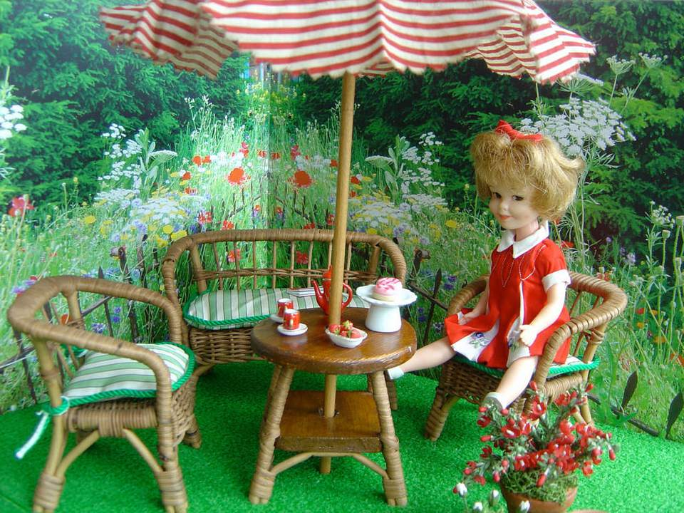 Betsy McCall doll with wicker furniture