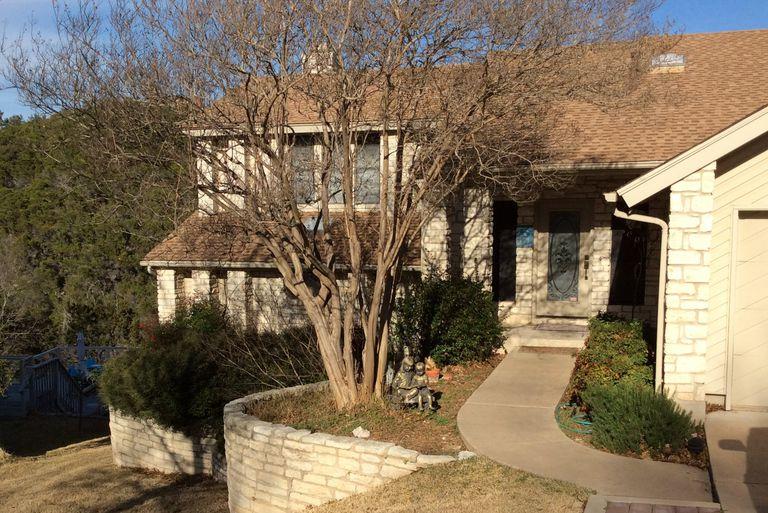 A White Stone Home with White Stone Retaining Wall in Austin, Texas