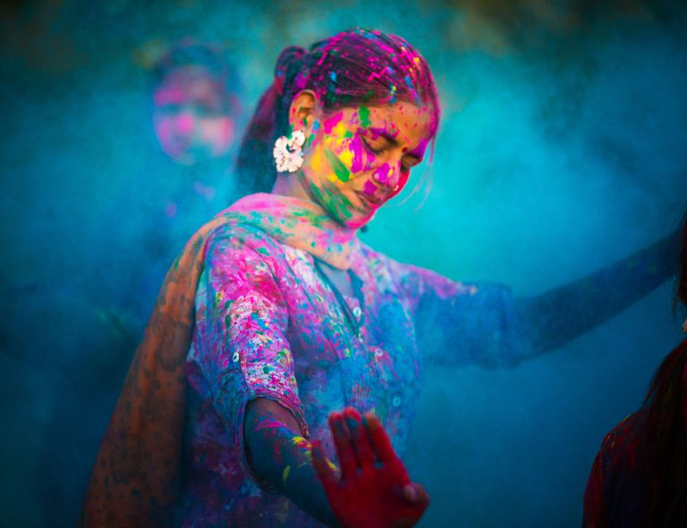 An Indian woman participating in a Holi celebration demonstrates the concept of culture as defined by sociologists.