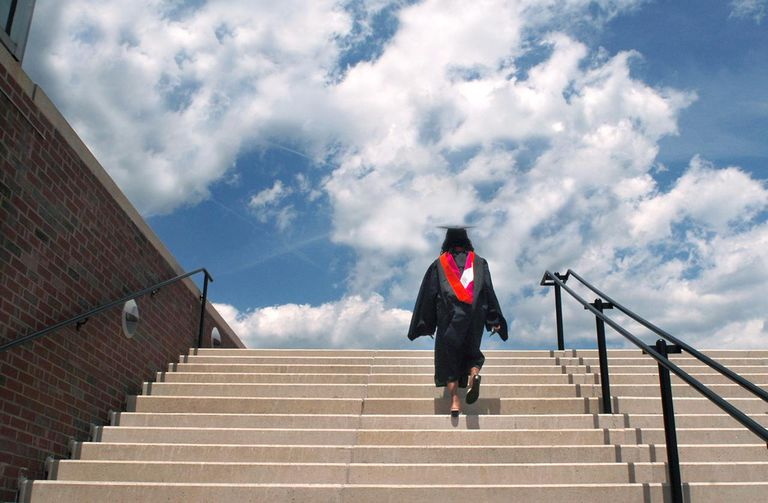 Woman walking up stairs to receive her Masters Degree, North Carolina State University, Raleigh, North Carolina