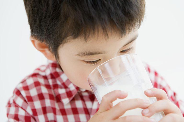 Asian boy drinking milk.
