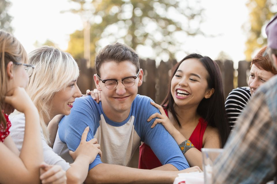 Friends talking at party