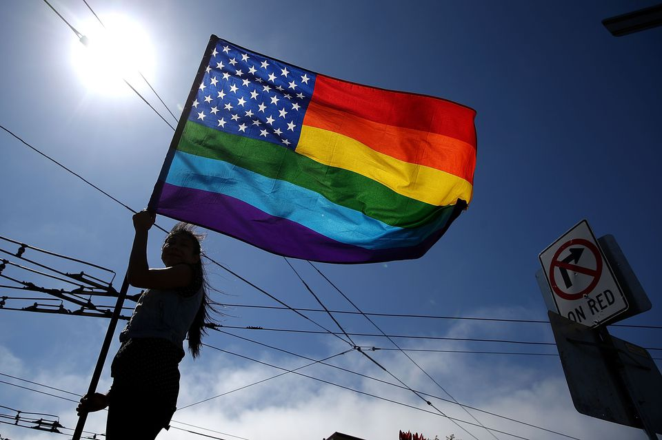 same-sex marriage supporter waves a pride flag