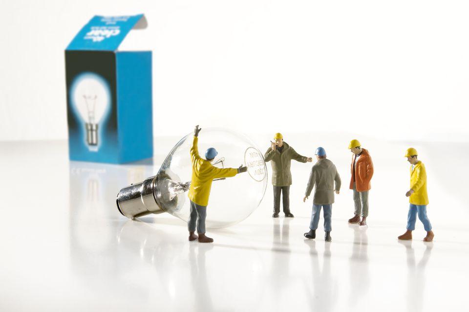 Utility Worker Figurines Installing Light Bulb