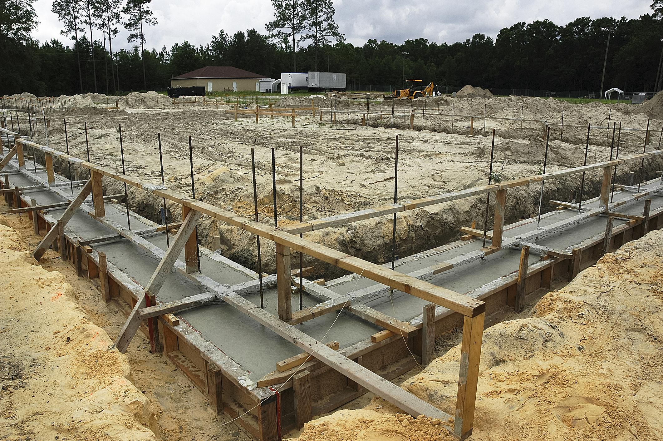 Guide to foundation footings building code for Basement foundations construction
