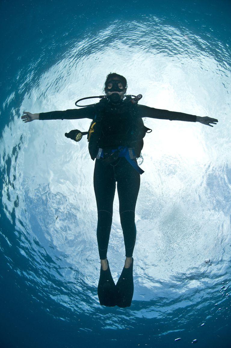 Wetsuit Diver, Scuba Diver Near Surface, Female Scuba Diver