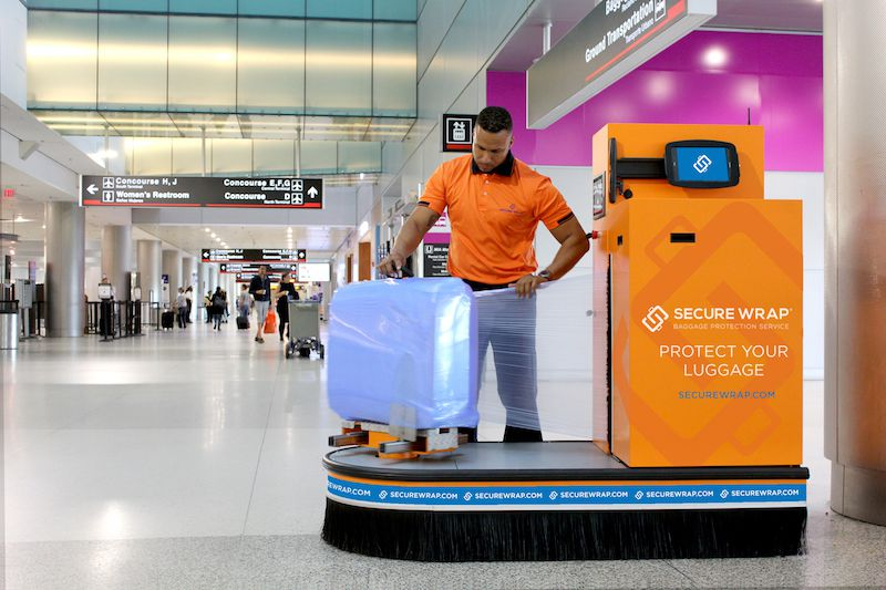 Plastic Wrap Car >> Baggage Wrapping Service Offers Peace of Mind for Travelers