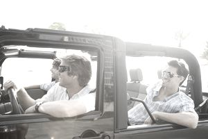 Friends riding in a jeep