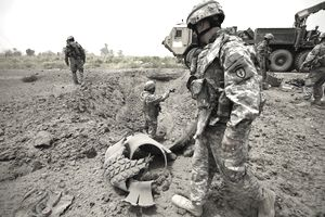 soldiers investigate an IED
