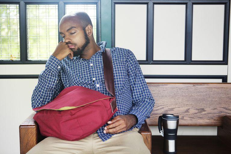 Man sleeping at subway station