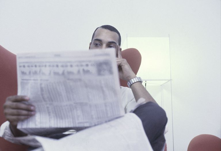 Businessman with Financial Paper