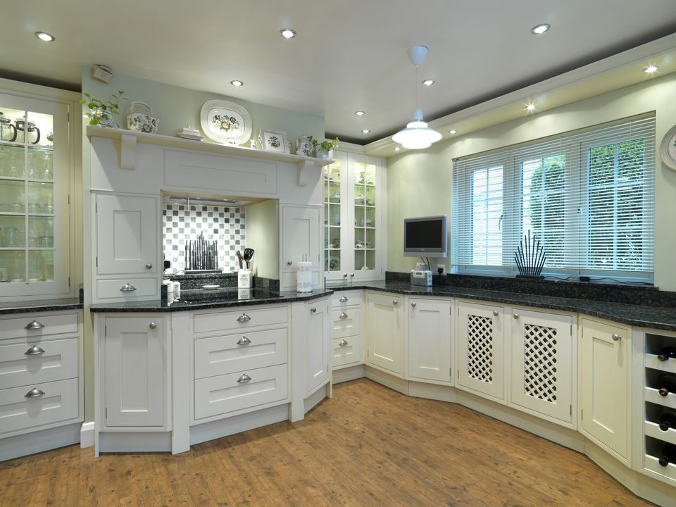 Traditional style kitchen with white units, UK home