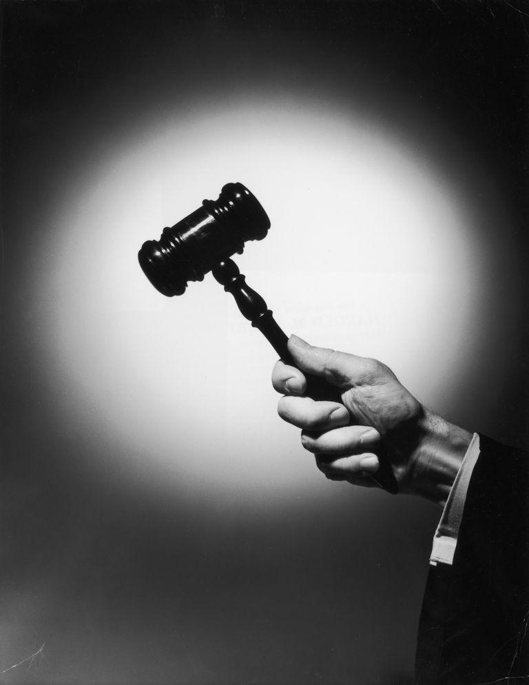 Judge's arm wielding the judicial gavel