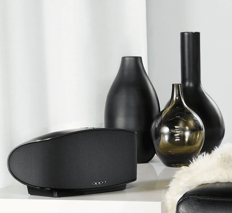 The OPPO Sonica speaker in front of a trio of vases
