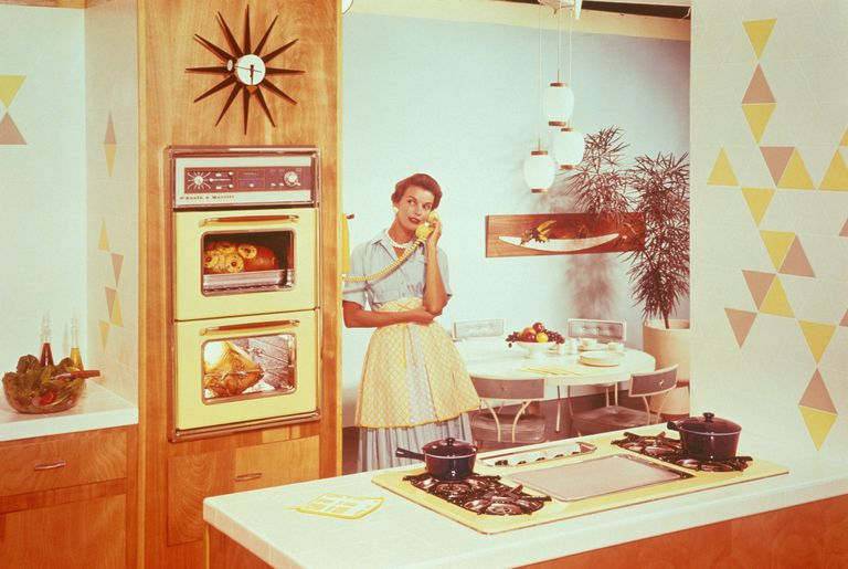 Housewife of the 1960s talking on the phone in her kitchen