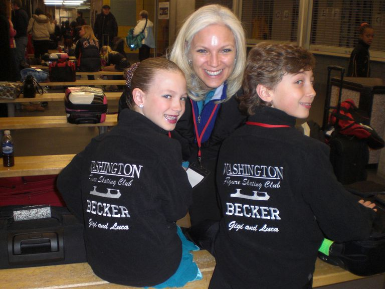 Young Figure Skaters Smile With Their Mother At a Figure Skating Competition