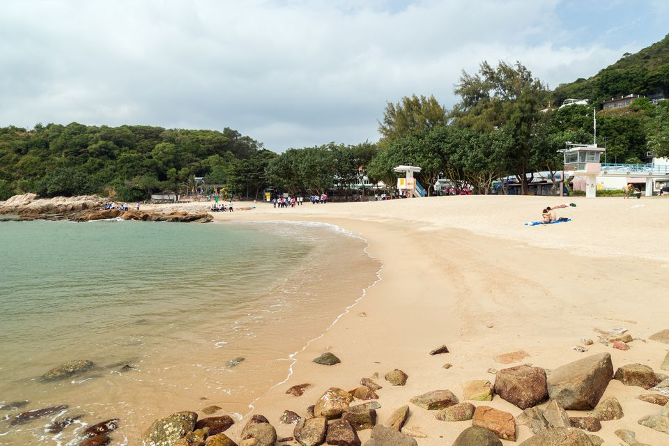 Schoolchildren and other people at the Hung Shing Yeh Beach on the Lamma Island in Hong Kong, China.