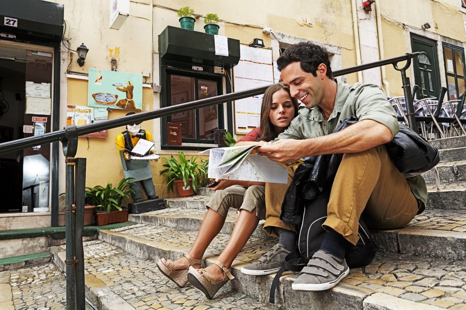 Couple looking at map in Portugal