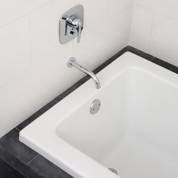 How to remove old caulk from your tub for Bathroom caulking service