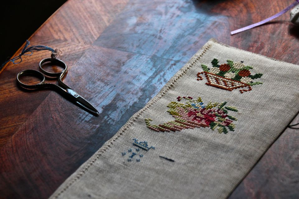 High Angle View Of Fabric With Scissor On Table