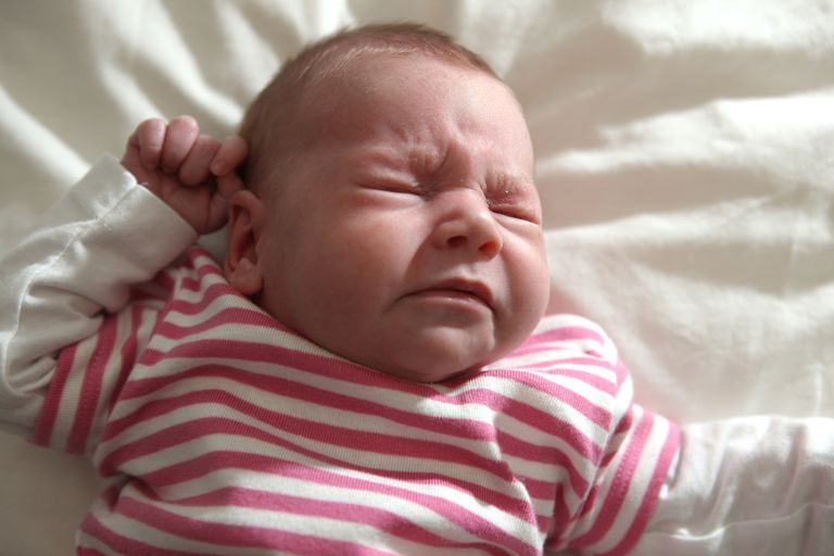 newborn baby girl sneezing