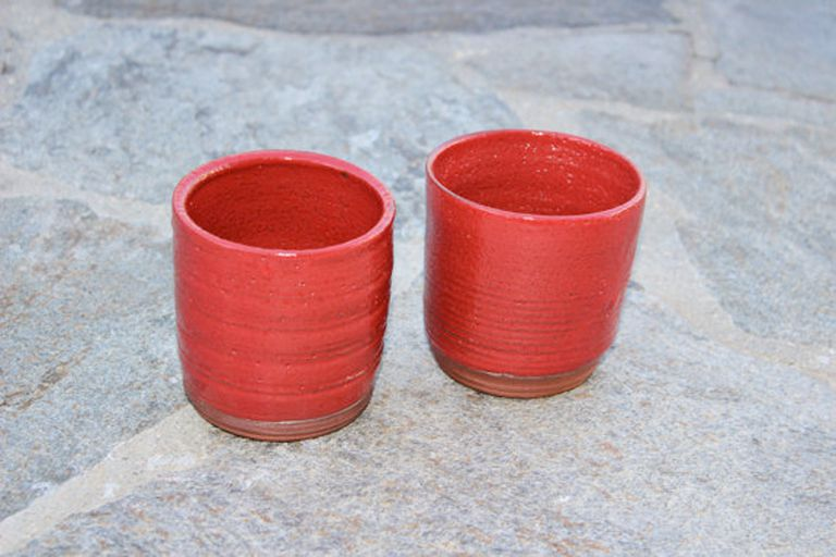 red ceramic tea mugs