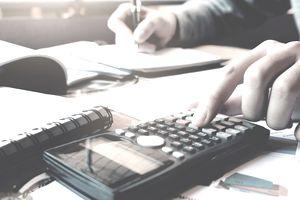 Close up woman hand pressing calculator