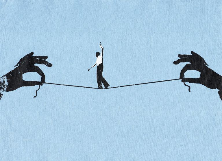 Illustration of businessman walking tightrope on string between two hands
