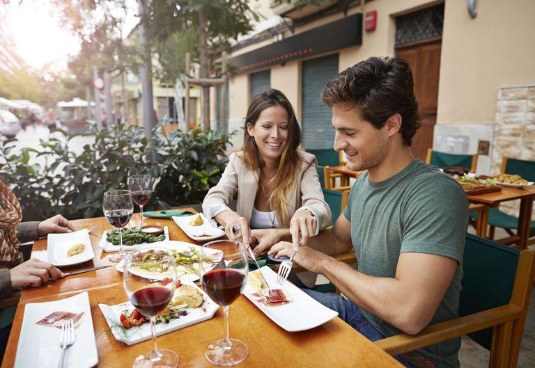 Couple sharing tapas at restaurant