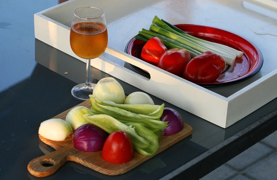 wine and vegetables on tray