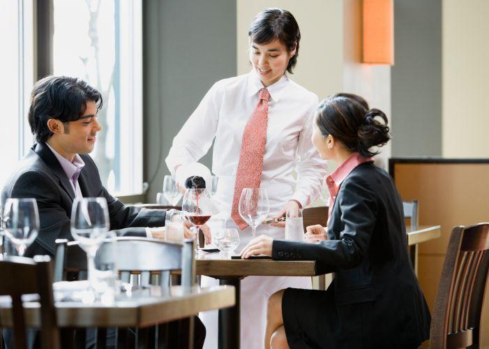 waitress pouring wine