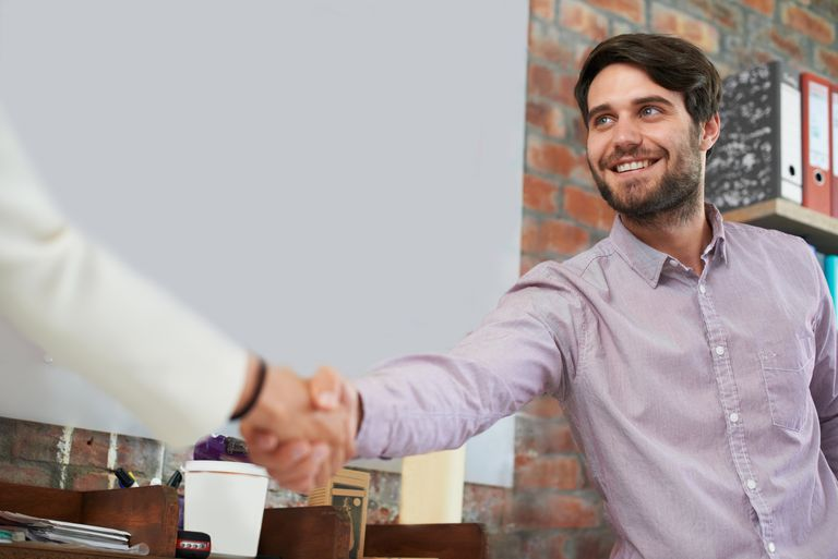 Shaking hands at a job interview