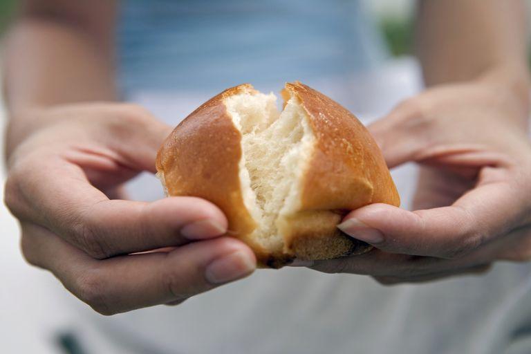 woman breaking bread