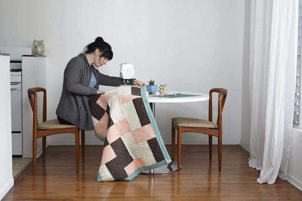 Woman quilting at home