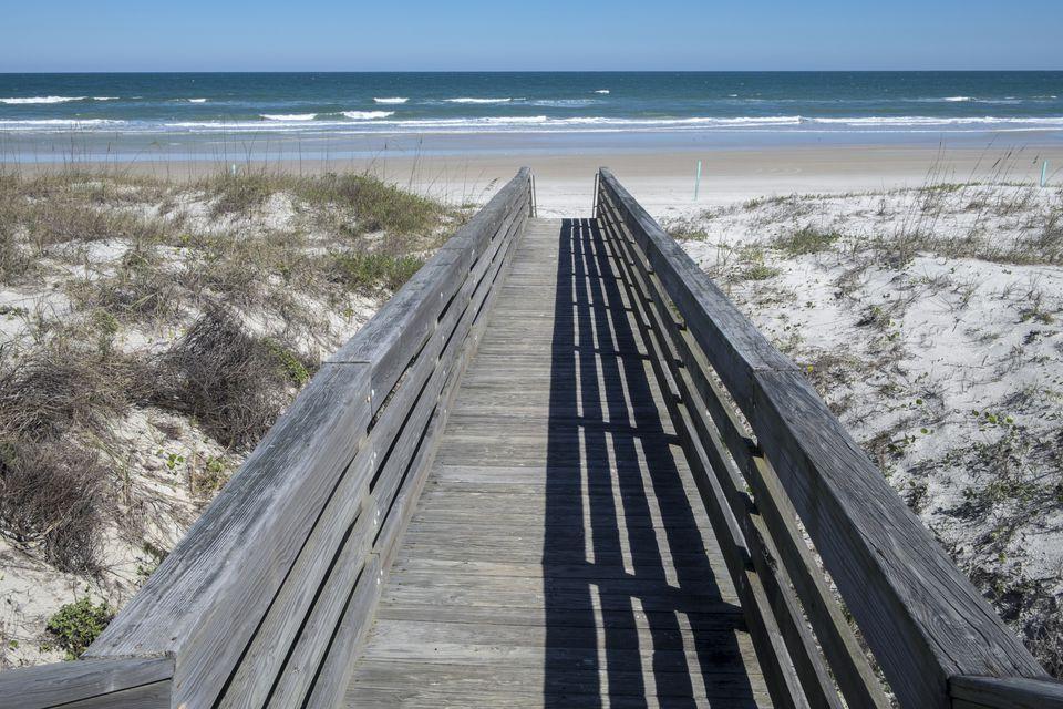 Wooden boardwalk by beach, Smyrna Dunes Park, New Smyrna Beach, Florida, USA