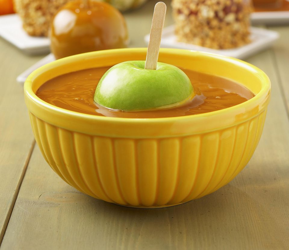 Granny Smith Apple in Bowl of Caramel