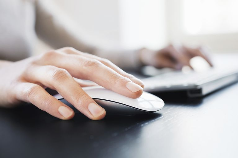 Hand with computer mouse.