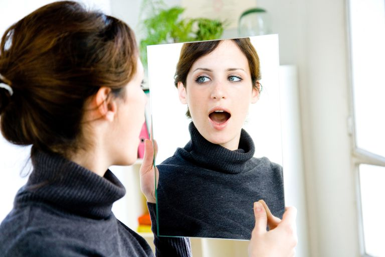 Speech therapy Treatment of stuttering : woman doing articulation and breathing exercises.