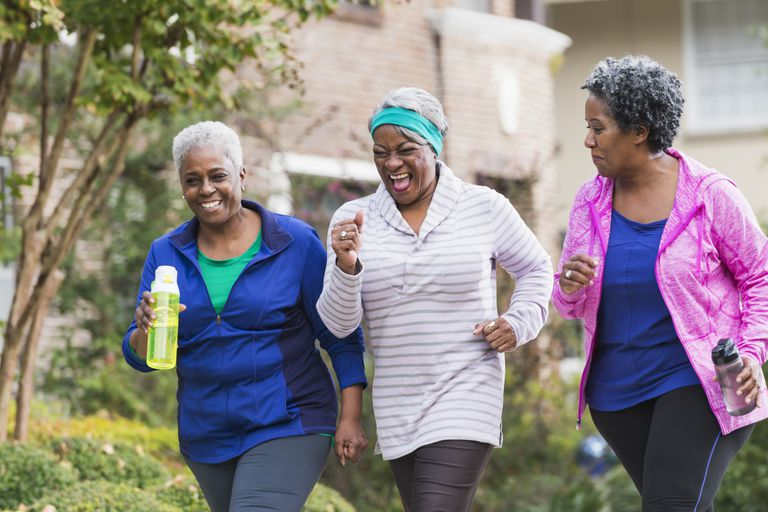 Three senior black women exercising together