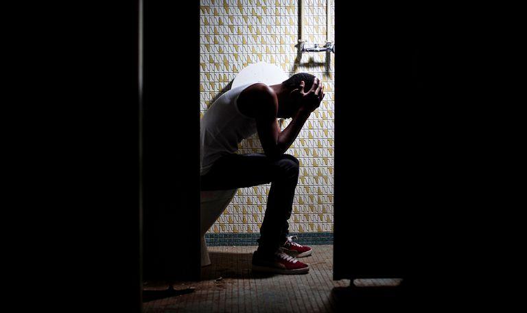troubled man in bathroom